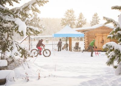 Photo of snowy day with bike kicksled and tent.