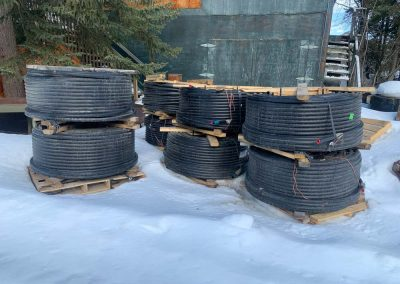 Photo of rolls of water hose.